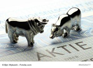 Börsensymbole Bulle und Bär auf einer deutschen Aktie - Aktiensparplan
